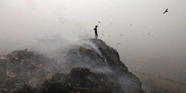 Garbage burning adding pollution to environment at Bhalswa Landfill as smog covers the capital's