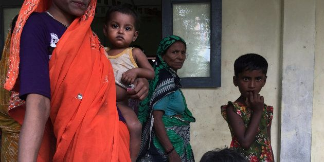 A Hindu family is seen at a shelter near Maungdaw, Rakhine state, Myanmar September 12, 2017.