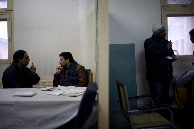 Kashmiris see a government psychiatrist, Dr. Arshad Hussain, center, at the Out Patient Department of...
