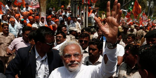 File photo of Narendra Modi, waving to his supporters as he arrives to file his nomination papers for...