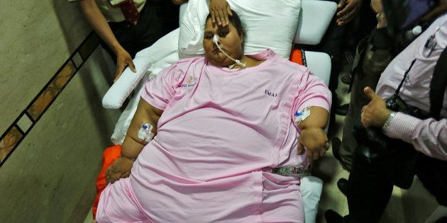 Eman Ahmed, an Egyptian woman who underwent weight loss surgery, is carried on a stretcher as she leaves...