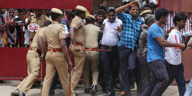 REPRESENTATIVE IMAGE: Policemen try to maintain the order of the fans of Indian superstar Rajinikanth...