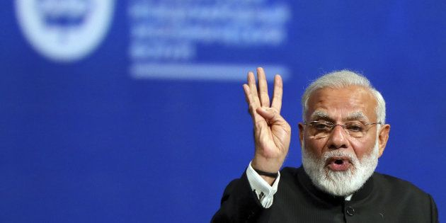 Indian Prime Minister Narendra Modi gestures during a session of the St. Petersburg International Economic...