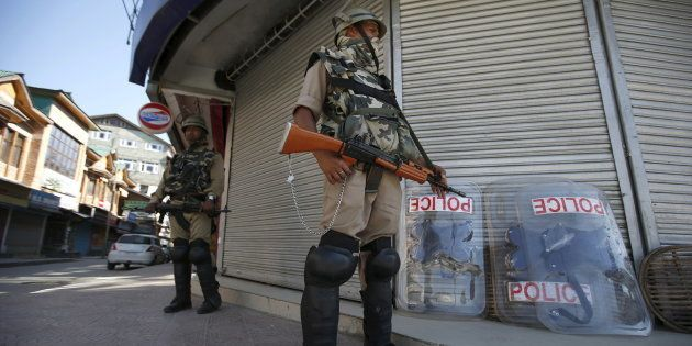 Representative image. Indian Central Reserve Police Force (CRPF) personnel stand guard in front of closed...