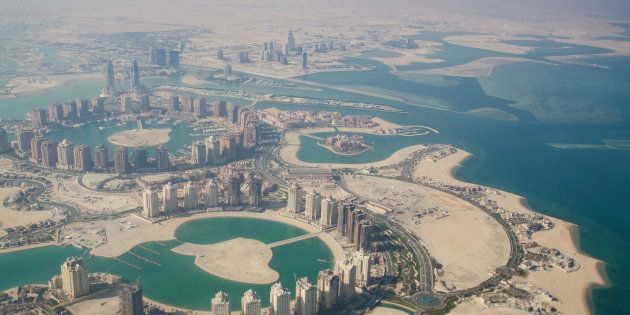 Flying over Qatar, Doha. The view from the airplane. Stock