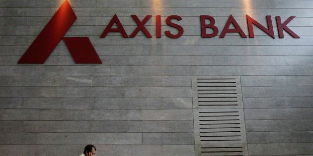 An employee speaks on his mobile phone as he walks inside Axis Bank's corporate headquarters in Mumbai...