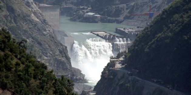 Water flows on the banks of Chenab River with the Baglihar hydroelectric project in the