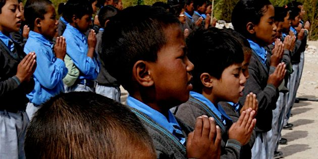 School children attend their morning assembly inside a charity school in Leh district of Buddhist dominated...