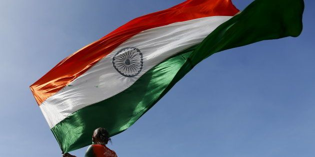 REPRESENTATIVE IMAGE: A supporter of the Indian cricket team waves the Indian national flag during the...