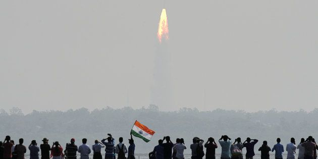 Indian onlookers watch the launch of the Indian Space Research Organisation (ISRO) Polar Satellite Launch...