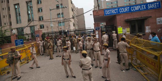 Delhi Police stand at the entrance of a