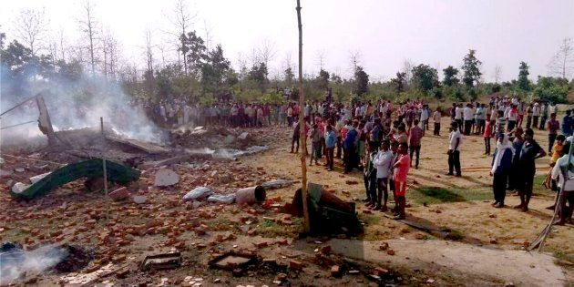 People gather near the site of a fire that took place in firecrackers factory at Balaghat, Madhya Pradesh...