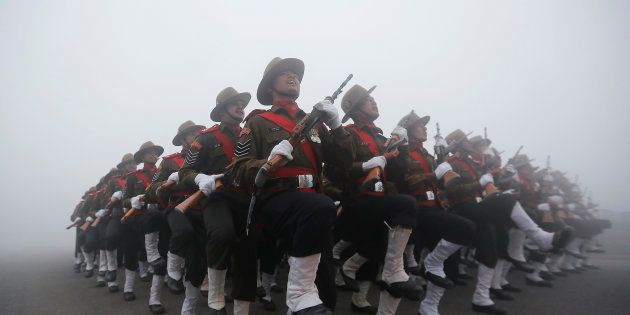 Indian soldiers take part in the rehearsal for the Republic Day parade on a foggy winter morning in New