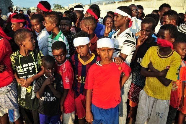 People wear headbands as a sign of anger as they protest against the deadly bomb attack in Mogadishu...