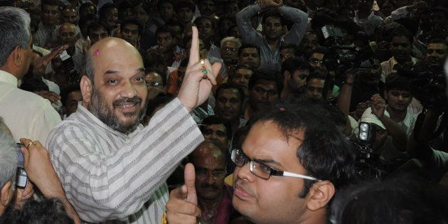 File photo of Indian politician and former Gujarat minister Amit Shah (L) and his son Jay celebrating...