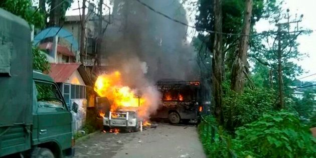 Police Vehicles in flames after being torched by Gorkha Janmukti Morcha (GJM) supporters in Darjeeling...