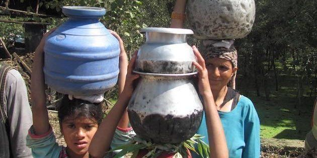 In The Absence Of Piped Water, Some Kashmiri Women Have To Trek Miles Uphill To Fetch Drinking