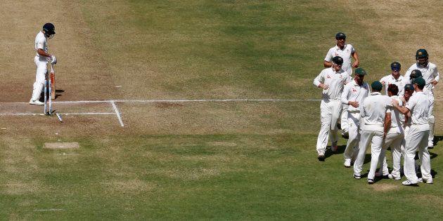 FILE PHOTO: Australia's players celebrate the wicket of India's captain Virat Kohli at the Maharashtra...