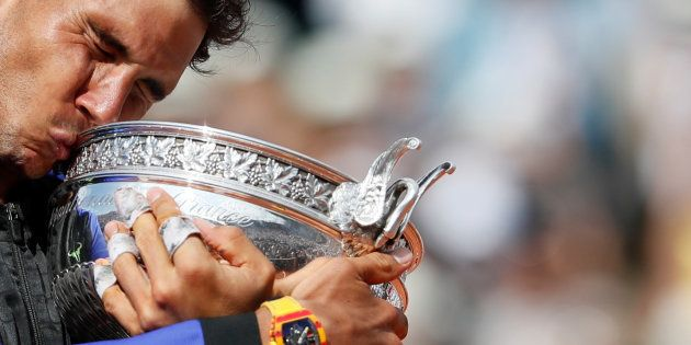 Spain's Rafael Nadal celebrates with the trophy after winning the final against Switzerland's Stan