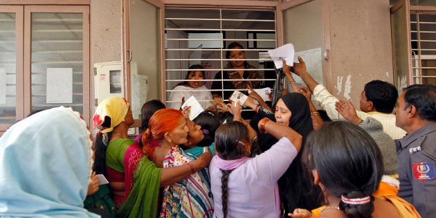 FILE PHOTO: Woman jostle to enrol themselves for Unique Identification (UID) database system in Ahmedabad...