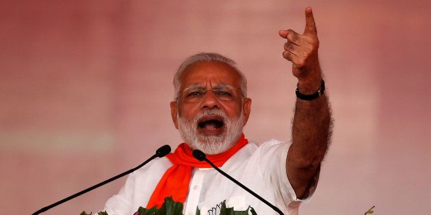 India's Prime Minister Narendra Modi addresses his supporters during a public rally at Bhaat village...