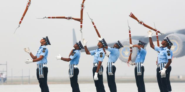 Indian Air Force soldiers toss their rifles as they perform during the full-dress rehearsal for Indian...
