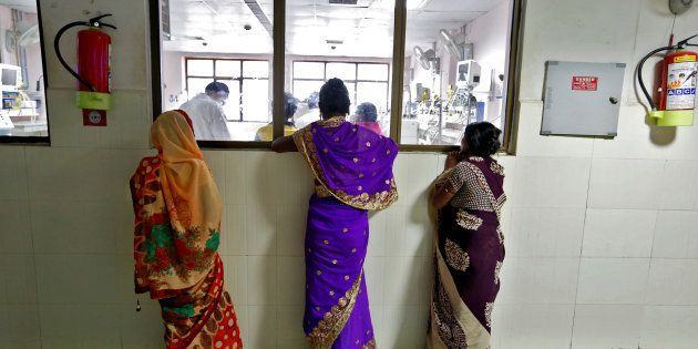 Women look into the Intensive care unit in the Baba Raghav Das hospital in Gorakhpur district, India...