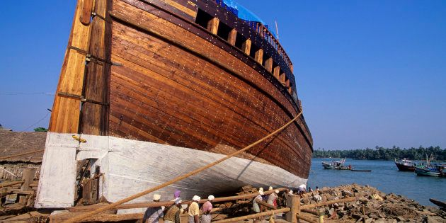 Dhow, a traditional Indian sailing vessel, under construction at the port in Beypore,