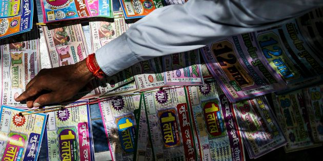 A roadside vendor arranges lottery tickets in Mumbai, India, on Wednesday, Aug. 21,