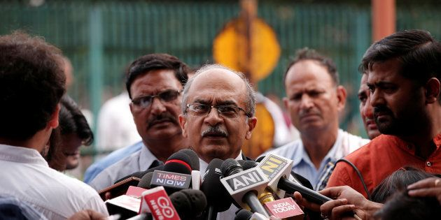 FILE PHOTO: Prashant Bhushan, a senior lawyer, speaks with the media after a verdict on right to privacy...