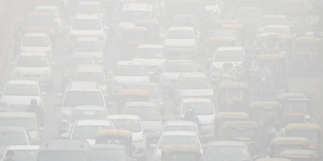 Vehicles drive through heavy smog in Delhi, India, November 8,
