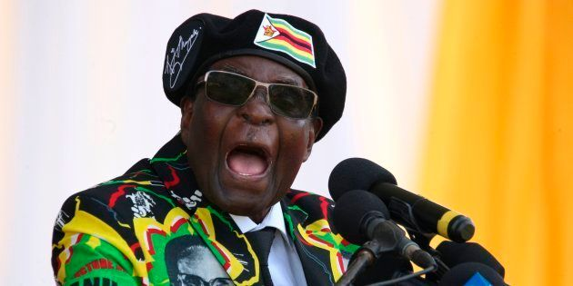 Zimbabwe's President Robert Mugabe delivers a speech during the Zimbabwe ruling party Zimbabwe African...