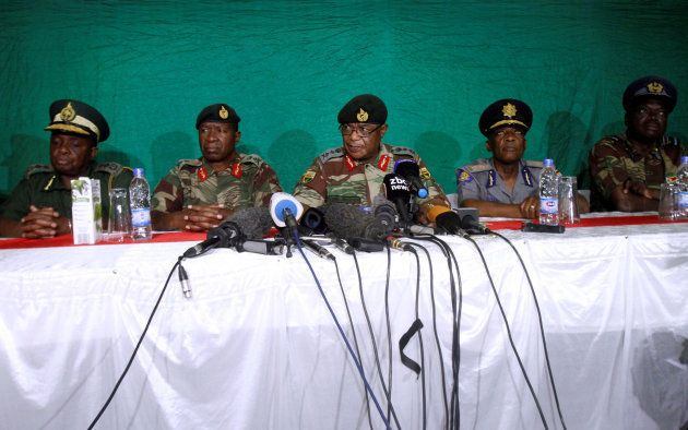 Commander of Zimbabwe Defence Forces General Costantino Chiwenga (C) addresses the media with other security...