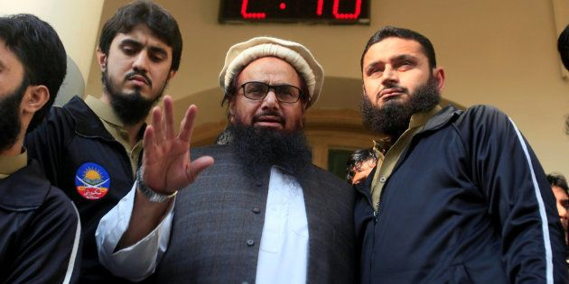 Hafiz Saeed speaks with supporters after attending Friday Prayers in Lahore, Pakistan November 24, 2017....