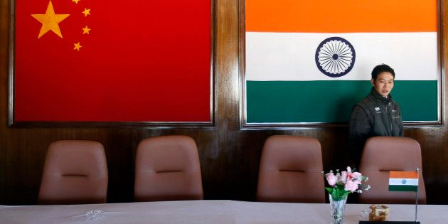 A man walks inside a conference room used for meetings between military commanders of China and India,...