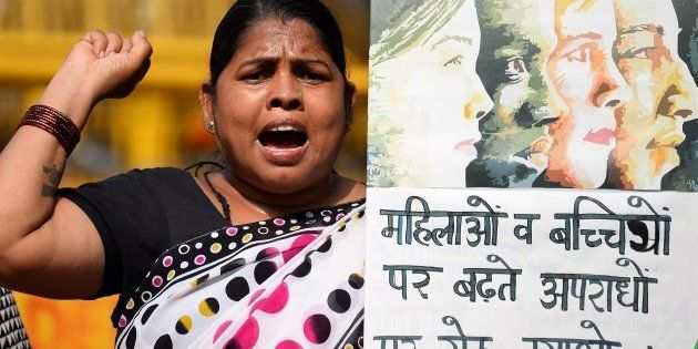 Indian social activists shouts slogans against the government of Prime Minister Narendra Modi during...
