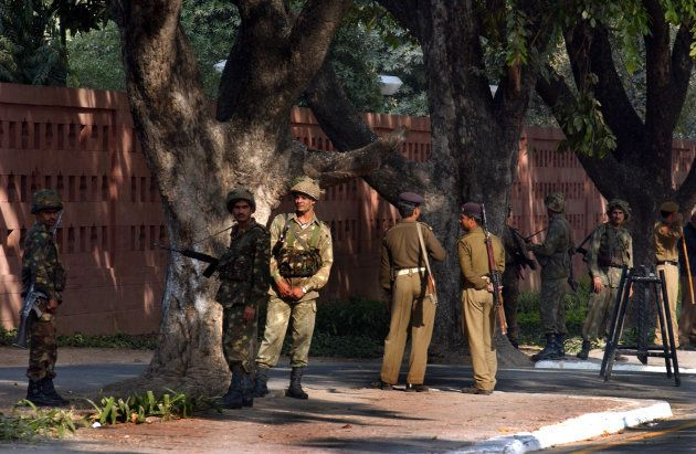 Indian military and police stand guard outside the Indian parliament building December 13, 2001 in New Delhi, India.