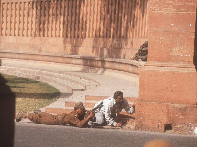 Security personnel take position after the Parliament was attacked in New Delhi, India.