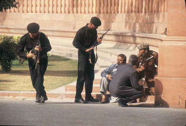 Security personnel take position at the Parliament.