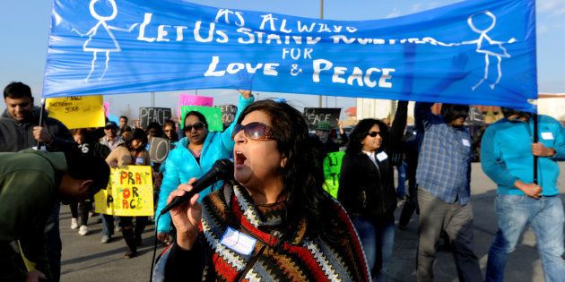 Hira Nair leads a chant during a march before a vigil for Srinivas Kuchibhotla, an Indian engineer who...