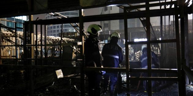 Firemen inspect the debris after a fire at a restaurant in Mumbai, India, December 29, 2017. REUTERS/...