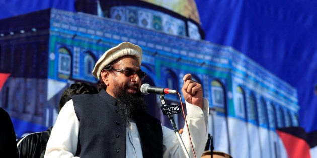 Hafiz Muhammad Saeed (C), chief of the Islamic charity organisation Jamaat-ud-Dawa (JuD), speaks to supporters...