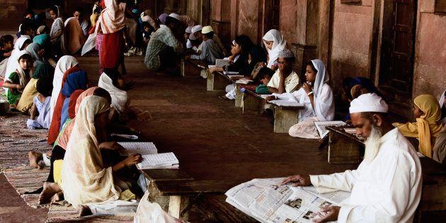Students studying in madrasa, Agra, Uttar Pradesh, India. (Photo by: Exotica.im/UIG via Getty