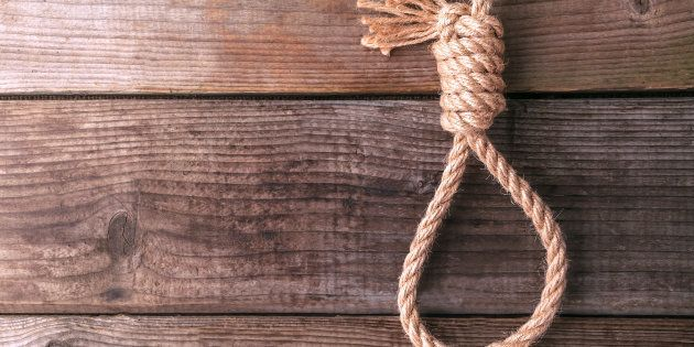 rope knotted in noose on wooden