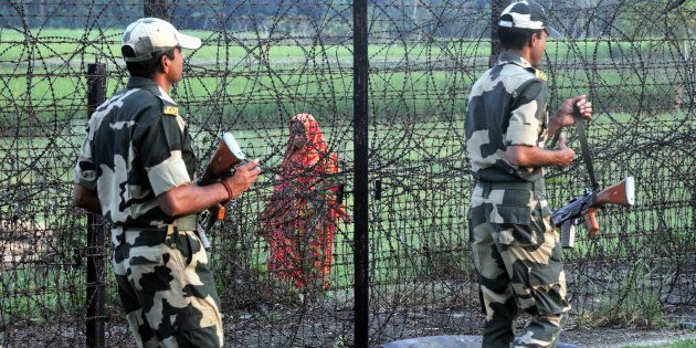 Indian Border Security Force (BSF) soldiers patrolling at the near Petrapole Border outpost at the India-Bangladesh...