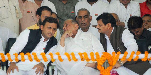 Uttar Pradesh Chief Minister Akhilesh Yadav talking to his father and SP chief Mulayam Singh Yadav while...