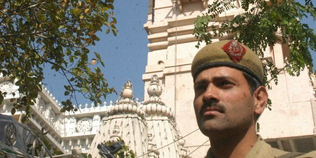 A Policeman guards the entrance of the Chattarpur Temple at Chattarpur Enclave, New