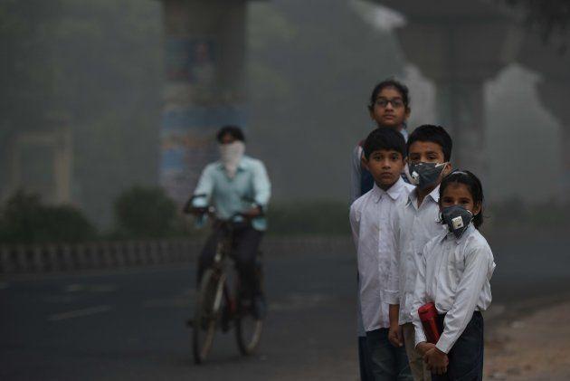 NEW DELHI, INDIA - NOVEMBER 8: School children leaving for school amid heavy smog, on November 8, 2017...
