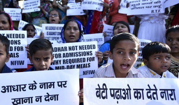 Children from government school protest at Shastri Bhawan against making Aadhar card mandatory for mid-day...