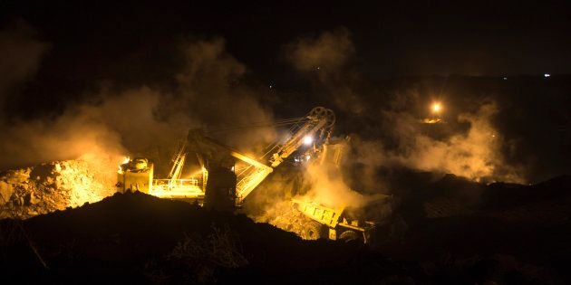 A truck is loaded with top soil at the Jharia burning coal field at Dhanbad district in the eastern Indian...
